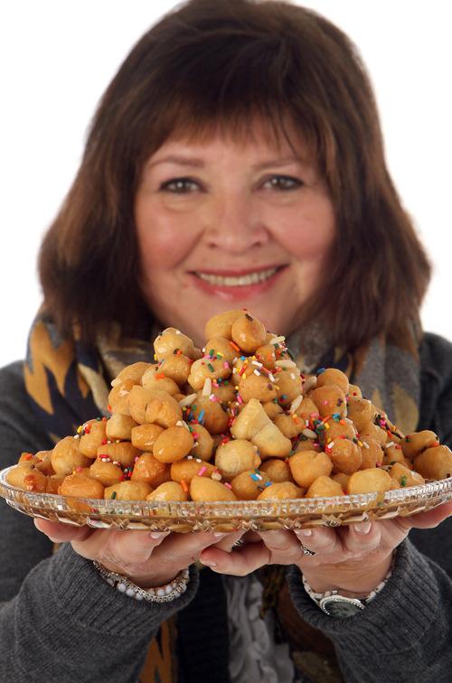 Francisco Kjolseth  |  The Salt Lake Tribune Marguerite Henderson with Struffoli (Italian honey balls).