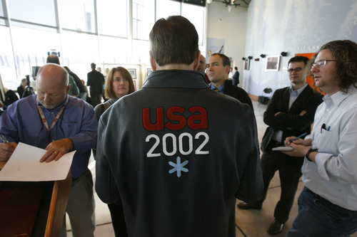 Francisco Kjolseth  |  The Salt Lake Tribune In a U.S. athlete coat from the 2002 Winter Olympics, former Salt Lake Organizing Committee chief operating officer Fraser Bullock answers reporters' questions after announcing plans next February to commemorate the 10th anniversary of the Winter Olympics being held in Salt Lake City.