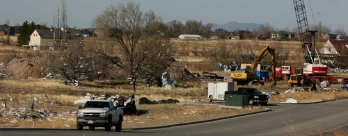 Leah Hogsten | The Salt Lake Tribune   Debris is strewn through Farmington from housing and business construction at Hunter Crossing in Farmington. Hurricane-force winds, in places topping 100 mph, ripped through Utah Thursday, overturning semitrailer rigs on Interstate 15, toppling trees and triggering widespread power outages affecting nearly 50,000 homes and businesses.