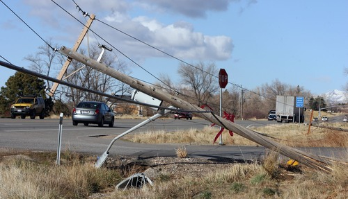 Steve Griffin  |  The Salt Lake Tribune Power lines along Highway 89 in Fruit Heights stretch across a side road Thursday after high winds whipped through the Wasatch Front.