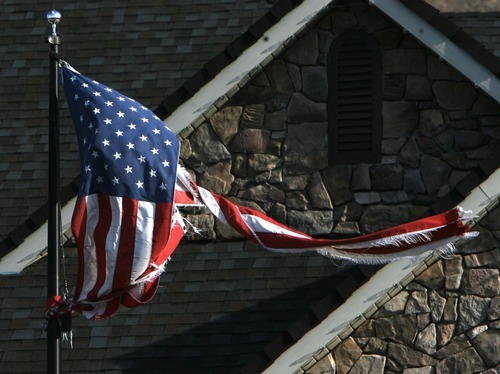 Steve Griffin  |  The Salt Lake Tribune  A frayed and torn American Flag blows in the wind in Fruit Heights on Thursday, Dec. 1, 2011 after high winds whipped through the Wasatch Front.