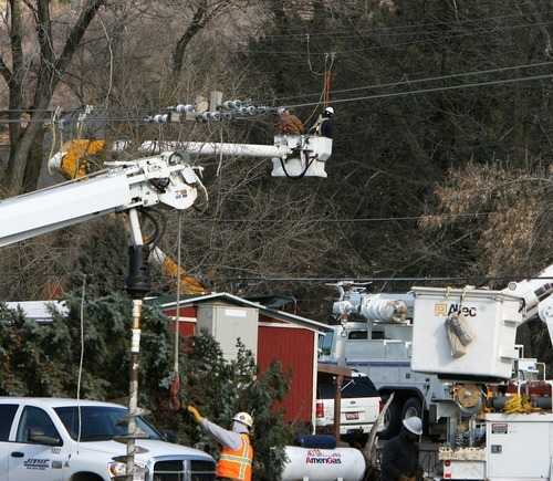 Steve Griffin  |  The Salt Lake Tribune  Power crews work on electric lines on HIghway 89 in Fruit Heights on Thursday, Dec. 1, 2011, after high winds downed trees along the Wasatch Front.