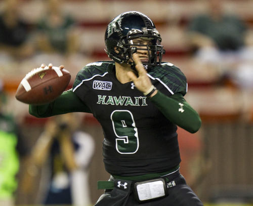 Hawaii quarterback Shane Austin (10) drops back to pass in the second quarter of an NCAA college football game Saturday, Nov. 19, 2011, in Honolulu. (AP Photo/Eugene Tanner)
