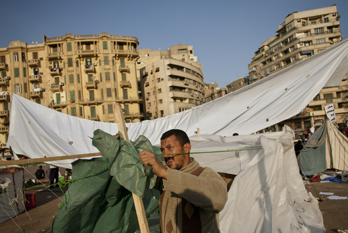 An Egyptian protester sets up a tent in Tahrir Square in Cairo, Egypt, Saturday, Dec. 3, 2011. Anticipating a strong presence in the new Egyptian parliament, ultraconservative Islamists have outlined plans for a strict brand of religious law, a move that could limit personal freedoms and steer a key U.S. ally toward an Islamic state. (AP Photo/Bernat Armangue)