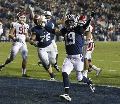 BYU's Matt Marshall, center, celebrates a touchdown in a game against New Mexico State during the second half of an NCAA college football game at LaVell Edwards Stadium, Saturday, Nov. 19, 2011, in Provo, Utah. BYU beat New Mexico State 42-7. (AP Photo/George Frey)