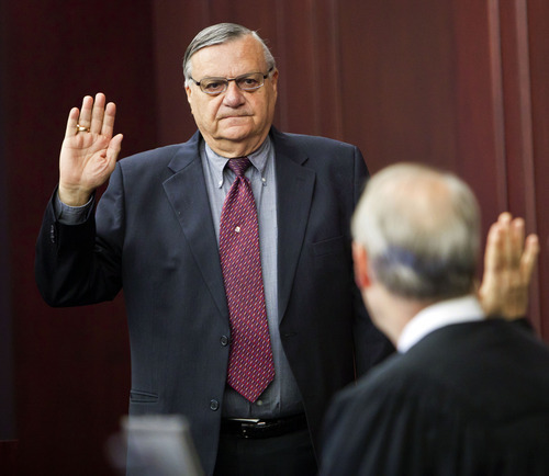 FILE - In this Oct. 18, 2011 file photo, presiding disciplinary Judge William O'Neil, right, swears in Maricopa County Sheriff Joe Arpaio during the State Bar of Arizona's ongoing disciplinary hearings against former Maricopa County attorney Andrew Thomas and two assistants, at the Arizona Supreme Court in Phoenix. According to some current and former police officers, hundreds of sex-crimes investigations have allegedly been mishandled by Arpaio's office. (AP Photo/Jack Kurtz, Pool, File)