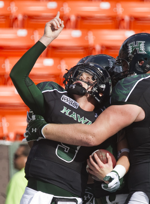 Hawaii quarterback David Graves (9) celebrates a touchdown which his teammates in the first quarter of an NCAA college football game on Saturday, Dec. 3, 2011, in Honolulu. (AP Photo/Eugene Tanner)