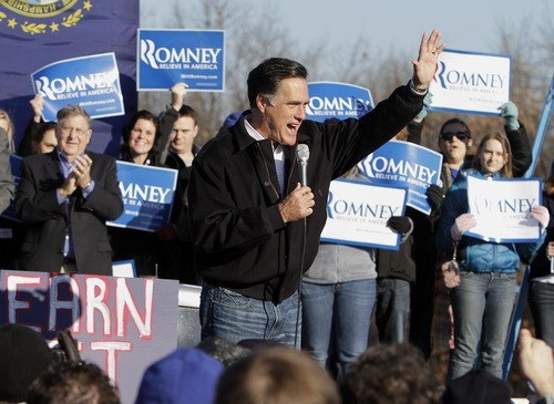 Republican presidential candidate, former Massachusetts Gov. Mitt Romney, speaks to supporters and volunteers during a rally Saturday, Dec. 3, 2011, in Manchester, N.H. (AP Photo/Jim Cole)