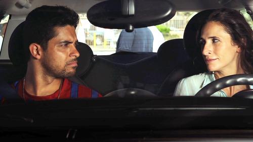 Wilmer Valderrama (left) and Michaela Watkins star in