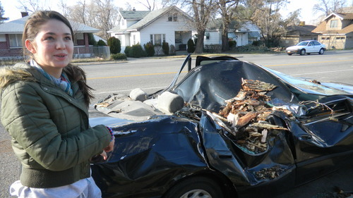 Kristen Moulton | The Salt Lake Tribune   Bianka Reyes tells how she heard the tree crack and hit the car belonging to her mother and step-father early Thursday morning on Ogden's Harrison Boulevard. The family, from Georgia, has been in Ogden more than two months.