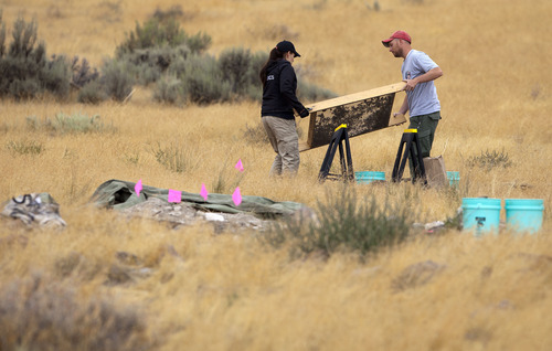 Jim Urquhart  |  The Associated Press Investigators screen soil from a hole excavated by law enforcement where search dogs indicated the smell of human tissue decomposition near the base of Topaz Mountain as law enforcement looks for missing Utah mother Susan Powell on Sept. 17, 2011, 50 miles northwest of Delta, Utah. Powell disappeared from her West Valley City home in December 2009 and hasn't been seen since.