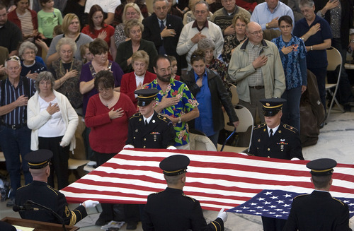 Al Hartmann  |  The Salt Lake Tribune  Surviving Pearl Harbor veterans from Utah were honored at a  ceremony remembering the 70th anniversary of the attack on Pearl Harbor at the Utah State Capitol Wednesday, Dec. 7. The Utah Military Honors Team performs a ceremonial flag presentation.