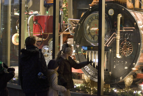 Paul Fraughton   The Salt Lake Tribune  Passersby stop to look at the Christmas window Monday at Deseret Book Store on South Temple Street in downtown Salt Lake City. The window features a whimsical