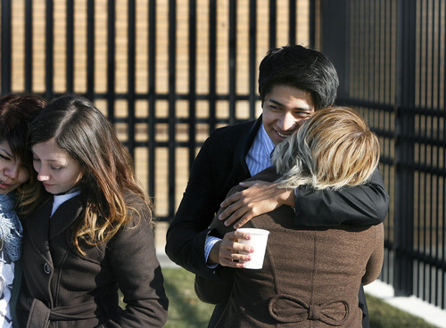 Scott Sommerdorf  |  The Salt Lake Tribune              David Morales is hugged by his friend Laura Ruiz, left, dabs tears after his  hearing in immigration court in West Valley City, Thursday, December 8, 2011. His case was continued until February 23rd.