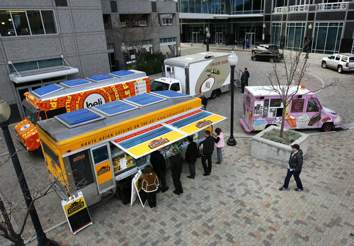 Scott Sommerdorf     The Salt Lake Tribune              Food trucks from Cruzin Sushi, Chow Truck, SoCupcake, Belli, and From Cakes to Crumbs sit at Gallivan Center Plaza, serving lunch, Thursday, December 1, 2011. Salt Lake City is looking to loosen rules on mobile food trucks to allow them to set up for 12-hour stints with a business and health dept. licenses. Right now, they are restricted to two hours and places like construction sites.