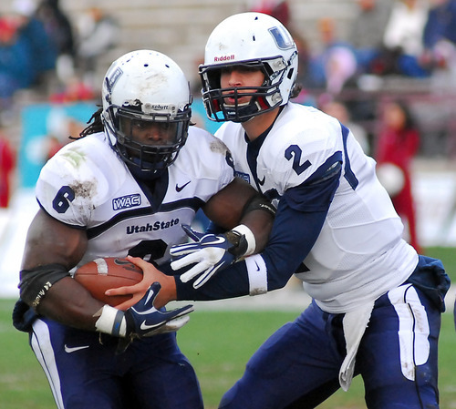 Utah State quarterback Adam Kennedy, right, hands the ball off to his running back Robert Turbin during an NCAA college football game against New Mexico State, Saturday, Dec. 3, 2011, in Las Cruces, N.M. (AP Photo/Las Cruces Sun-News, Robin Zielinski)