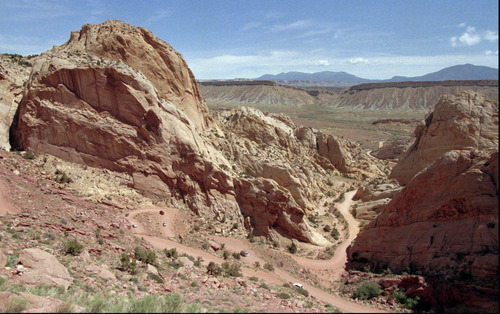 AP File Photo This 1997 photo shows vehicles traveling on the switchbacks of the famed Burr Trail road in Capitol Reef National Park, Utah as part of a lawsuit over paving the road. The controversy may be reopening with a new plan to pave a mile-long section, including the switchbacks.