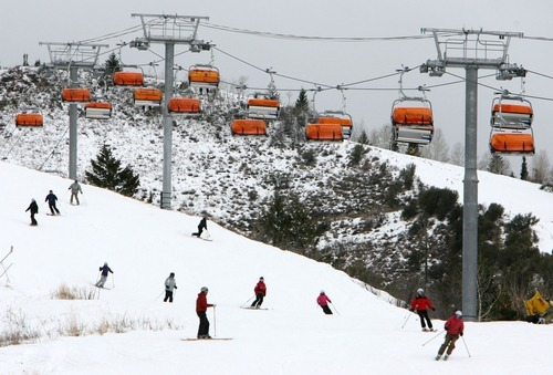 Steve Griffin | Tribune file photo Skiers and boarders zip down a run under the Orange Bubble Express ski lift during opening day at the Canyons Resort in Park City. Studies justifying the Canyons-to-Solitude gondola have been released. The report said the project could immediately add $51 million to Utah's economy.