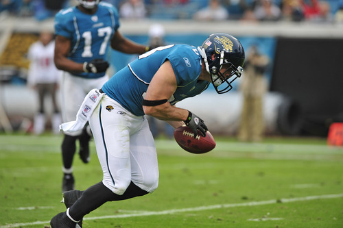 Jacksonville Jaguars' Colin Cloherty recovers a Tampa Bay Buccaneers fumble to return it for an 8-yard touchdown during the first half of an NFL football game on Sunday, Dec. 11, 2011, in Jacksonville, Fla. (AP Photo/Stephen Morton)