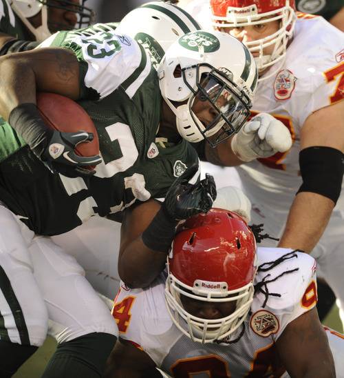 New York Jets' Shonn Greene (23) runs the ball during the second quarter of the NFL football game against the Kansas City Chiefs on Sunday, Dec. 11, 2011, in East Rutherford, N.J. (AP Photo/Bill Kostroun)