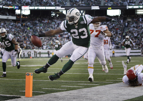New York Jets' Shonn Greene gets his hand on the ball before running out of bounds during the second quarter of the NFL football game against the Kansas City Chiefs on Sunday, Dec. 11, 2011, in East Rutherford, N.J. (AP Photo/Kathy Willens)