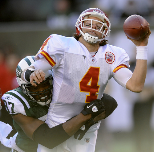 Kansas City Chiefs quarterback Tyler Palko (4) is sacked by New York Jets' Calvin Pace during the second quarter of the NFL football game on Sunday, Dec. 11, 2011, in East Rutherford, N.J. (AP Photo/Bill Kostroun)