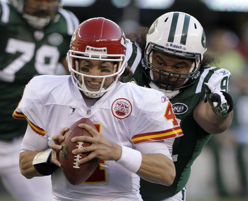 New York Jets' Sione Pouha, right, sacks Kansas City Chiefs quarterback Tyler Palko (4) during the second quarter of an NFL football game on Sunday, Dec. 11, 2011, in East Rutherford, N.J. (AP Photo/Kathy Willens)