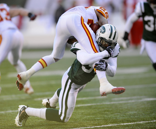 New York Jets' Tracy Wilson, bottom, tackles Kansas City Chiefs' Dexter McCluster during the second quarter of an NFL football game on Sunday, Dec. 11, 2011, in East Rutherford, N.J. (AP Photo/Bill Kostroun)