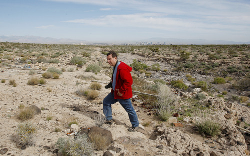 Rolf Koecher searches for his son Steven on April 10, 2010,  in Henderson, Nev., where Steven was last seen on a surveillance video. Rolf Koecher died earlier this year. Isaac Brekken for The Tribune
