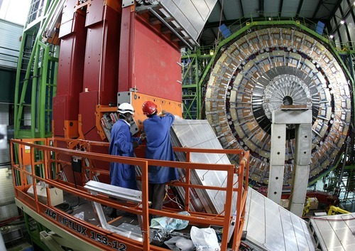 Engineers work in March 2007 to assemble one of the layers of the world's largest superconducting solenoid magnet (CMS, Compact Muon Solenoid) at the European Organization for Nuclear Research (CERN)'s Large Hadron Collider (LHC) particule accelerator, in Geneva, Switzerland. Scientists at CERN will  hold a public seminar Tuesday Dec. 13, 2011  to present their latest findings from the search for an elusive sub-atomic particle known as the Higgs boson. Physicists are increasingly confident that they have narrowed down the place where it will be found and may even already have hints at its existence hidden away in reams of data. (AP Photo/KEYSTONE/Martial Trezzini, File)