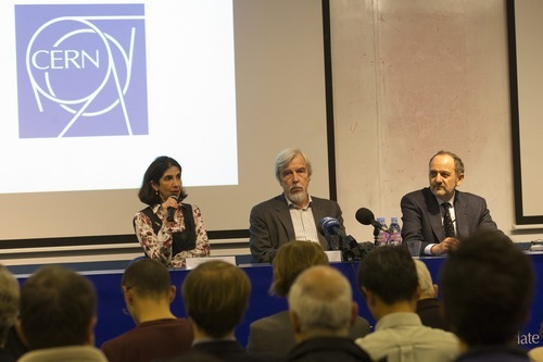 The Associated Press Professor Fabiola Gianotti, left, Atlas Collaboration spokesperson, German Rolf-Dieter Heuer, director general of CERN, and Professor Guido Tonelli, CMS Collaboration Spokesperson, speak to the media Tuesday about the Higgs Boson search at the European Particle Physics laborator in Geneva, Switzerland.
