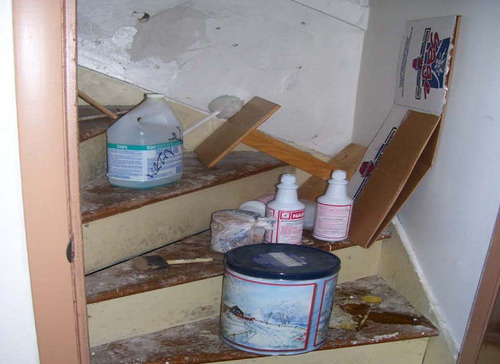 This undated handout photo provided by the Department of Health and Human Services shows paint and cleaning supplies in an unlocked stairwell accessible to children in Milwaukee, Wis., from a HHS report. It's the kind of stuff that gives moms nightmares: a machete near a play area, household chemicals accessible to preschoolers, and instructors teaching without a criminal background check. These violations and others were found at Head Start centers across the country, according to a report released Tuesday, Dec. 13, 2011, by the inspector general of the Health and Human Services Department.(AP Photo/HHS)