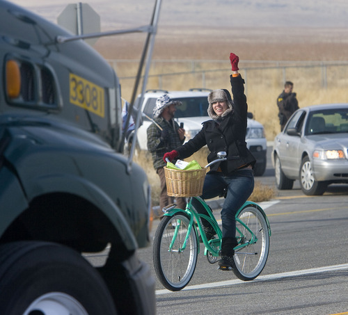 Al Hartmann  |  The Salt Lake Tribune Members of OWS-Salt Lake staged a protest at the WalMart distribution center west of Granstville on Monday, Dec. 12, 2011. They slowly rode bikes in small groups along State Road 138 disrupting the flow of traffic in and out of the distribution center.