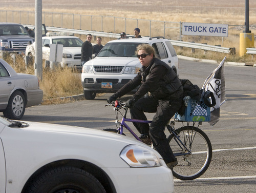Al Hartmann  |  The Salt Lake Tribune Members of OWS-Salt Lake staged a protest at the WalMart distribution center west of Granstville Monday December 12.  They slowly rode bikes in small groups along State Road 138 disrupting the flow of traffic in and out of the distribution center.