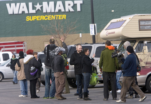 Al Hartmann  |  The Salt Lake Tribune Members of Occupy Salt Lake City gather in a parking lot Monday morning before entering the Walmart Super Center in Tooele, where several entered and read from a prepared script in which they urged Walmart employees to unionize. After several minutes, store officials escorted the Occupiers to the door.