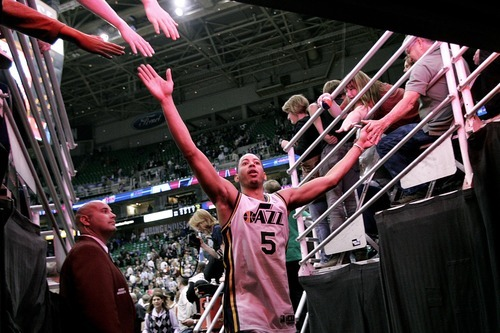 Djamila Grossman  |  The Salt Lake Tribune  The Utah Jazz' Devin Harris (5) walks off the court after his team won against the Denver Nuggets during the second half of a game at Energy Solutions Arena in Salt Lake City, Utah, on Wednesday, April 13, 2011.
