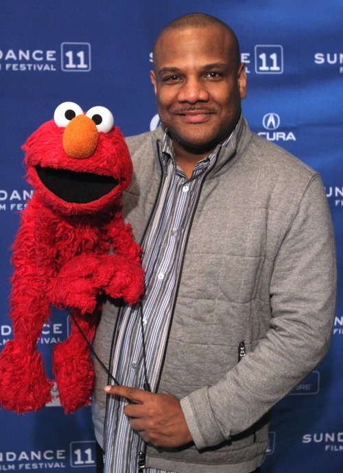 Rick Egan      The Salt Lake Tribune Puppeteer Kevin Clash is shown with Elmo in Park City on Jan. 23 before the screening of