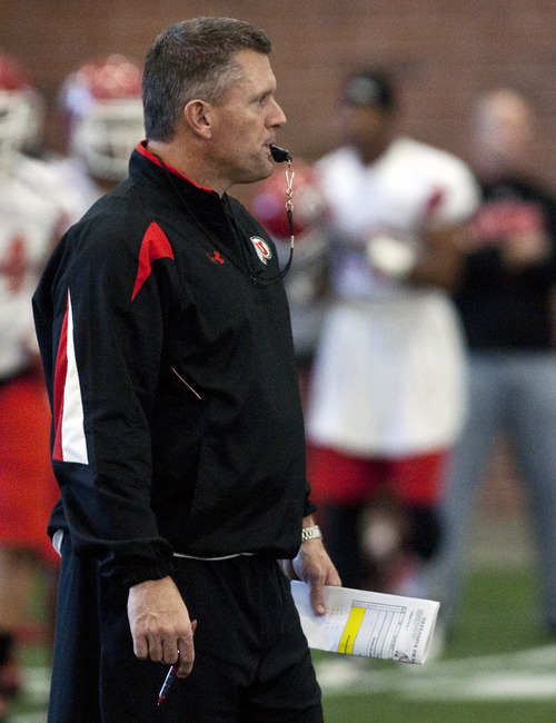 Utah head coach Kyle Whittingham gives direction during an NCAA college football practice Thursday, Dec. 8, 2011, in Salt Lake City. Utah is scheduled to face Georgia Tech in the Sun Bowl on Dec. 31. (AP Photo/The Salt Lake Tribune, Chris Detrick)  DESERET NEWS OUT; LOCAL TV OUT; MAGS OUT