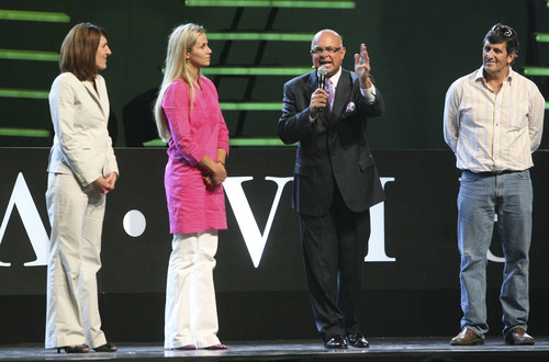 Leah Hogsten  |  Tribune file photo Dallin Larsen, center, is the founder, chairman and CEO of MonaVie, a nutritional drink company that says it has sold $2 billion worth of its products since its founding in 2005.
