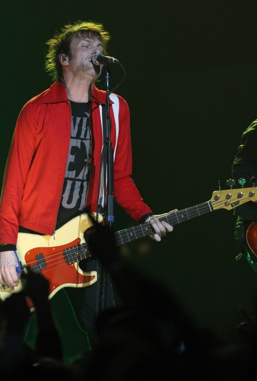 Rick Egan  | The Salt Lake Tribune   Tommy Stinson plays bass for Guns  N' Roses performs with his band at the Maverick Center, late Tuesday, December 13, 2011.