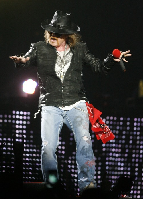 Rick Egan  | The Salt Lake Tribune   Axl Rose, lead vocals for Guns  N' Roses performs with his band at the Maverick Center, late Tuesday, December 13, 2011.