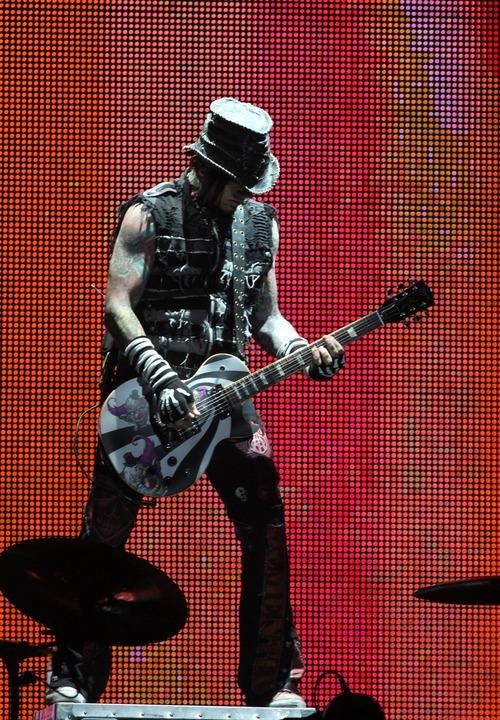 Rick Egan  | The Salt Lake Tribune   DJ Ashba, lead guitar for Guns N' Roses performs with his band at the Maverick Center, late Tuesday, December 13, 2011.