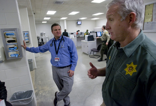 Al Hartmann  |  The Salt Lake Tribune Salt Lake County's Adult Detention Center has a medical unit where prisoners are treated. Medical director Dr. Todd Wilcox, left, works with Sheriff Jim Winder.