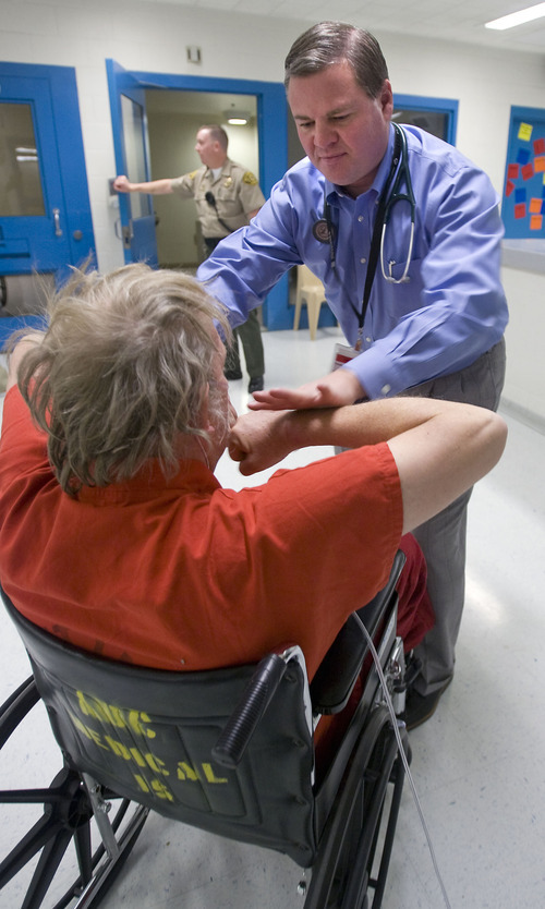 Al Hartmann  |  The Salt Lake Tribune Medical director Dr. Todd Wilcox examines a prisoner who has a heart condition in the medical unit of Salt Lake County's Adult Detention Center.