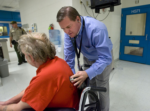 Al Hartmann     The Salt Lake Tribune Medical director Dr. Todd Wilcox examines a prisoner who has a heart condition in the medical unit of Salt Lake County's Adult Detention Center.