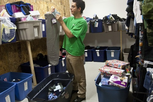 Chris Detrick  |  The Salt Lake Tribune Volunteer Robert F. Westfall helps to sort donated clothes and toys Thursday for the 25th annual Sub for Santa program in Nephi. Sub for Santa is a Christmas assistance program for families in Juab County.