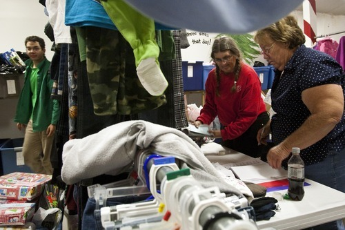 Chris Detrick  |  The Salt Lake Tribune Volunteers Judy Jensen, right, Cathy Adams and Robert F. Westfall  sort donated clothes and toys Thursday for the 25th annual Sub for Santa program in Nephi. Sub for Santa is a Christmas assistance program for families in Juab County.