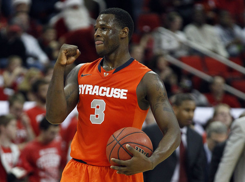 Gerry Broome | The Associated Press Syracuse's Dion Waiters (3) reacts during the second half of an NCAA college basketball game against North Carolina State in Raleigh, N.C., Saturday, Dec. 17, 2011. Syracuse won 88-72. (AP Photo/Gerry Broome)