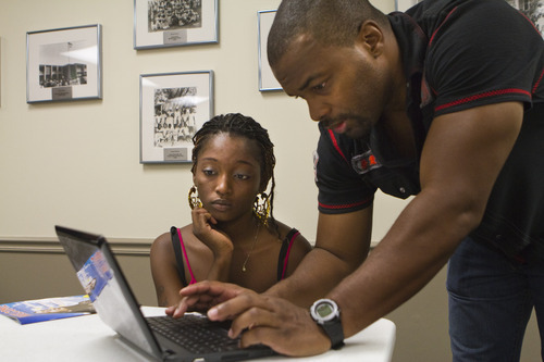 Michael Thomas, right, local advocate in Tampa, Fla., works with students in the American Academy's No Dropouts program. Courtesy photo