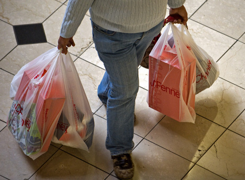 A shopper at the Brea Mall in Brea, Calif., carries bags full of packages Sunday, Dec. 26, 2010. So far, it's been the best holiday season for retailers since 2007, which was a record year. (AP Photo/Orange County Register, Michael Goulding)  NO SALES; MAGS OUT; LOS ANGELES TIMES OUT